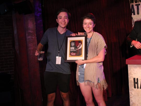 Jess Bryant and Peter Seifarth, known as Panda Head Theatre, from Cashiers, N.C., accept the David C Herriman Artists' Pick of the Fringe Award on Saturday nigh at the Know Theatre of Cincinnati. The award was voted on by artists who participated in the 2017 Cincinnati Fringe Festival.