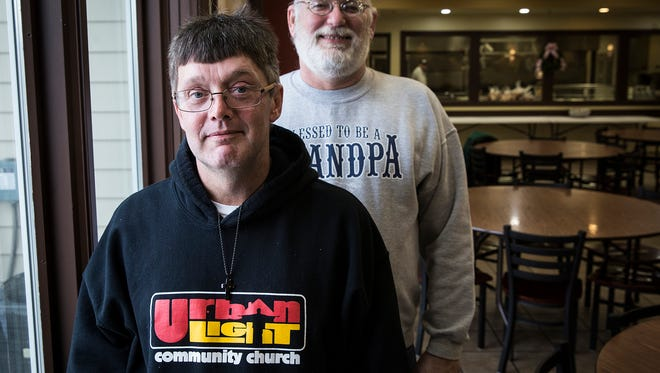 Accountability partners Steve Croyle Jr. and Scott Wykoff in the cafeteria at the Muncie Mission Friday.