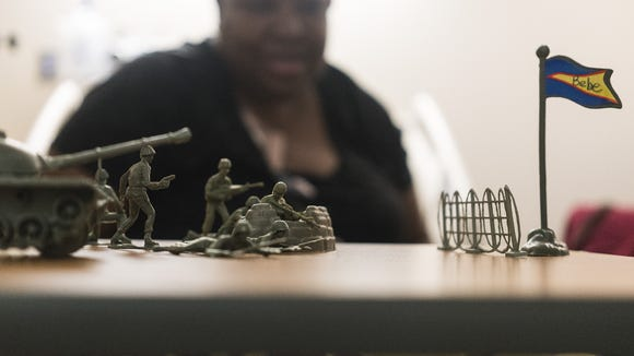 """Donna McHenry, who has been diagnosed with cancer, is optimistic through her chemotherapy treatments, setting up little green plastic Army men to help her fight. """"I'm going to get well,"""" she said."""