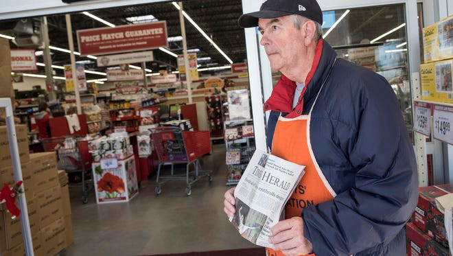 Ron Young sells copies of the Times Herald in the entry of Tractor Supply Co. in Fort Gratiot Dec. 1.