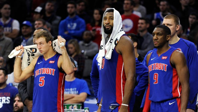The Detroit Pistons' Luke Kennard, Andre Drummond and Langston Galloway watch the final minutes of the second half from the bench during Saturday night's loss to the Philadelphia 76ers.