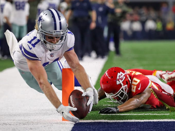 Dallas Cowboys wide receiver Cole Beasley (11) dives and scores a touchdown past Kansas City Chiefs cornerback Steven Nelson.