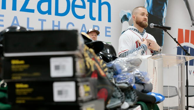 Cincinnati Reds catcher Tucker Barnhart talks about the importance of maintaining good grades as a high school athlete to open doors for a future beyond sports during an event at the Town & Country Athletic Center in Wilder, Ky., on Wednesday, Jan. 25, 2017. St. Elizabeth Healthcare and the Reds teamed up to donate $15,000 worth of baseball and softball equipment to five Northern Kentucky schools.