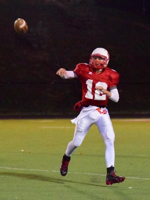 Beechwood Quarterback Kyle Fieger completes a pass for the Tigers last season in the Class 1A playoffs.