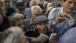 Pensioners try to enter a bank in Athens on July 1,