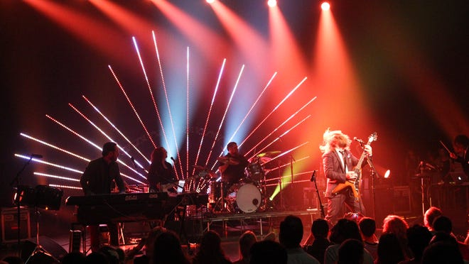 Jim James hammers out the riffs on his Flying V as drummer Dave Givan and Kevin Ratterman, right, jam along at the sold-out Brown Theatre Wednesday night in Louisville for his debut solo album Regions of Light and Sound of God. (By Matt Stone, The Courier-Journal) April 17, 2013