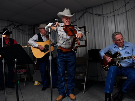 """""""Fingerless Fiddler"""" Roy Thackerson performs with Wesley Allbright (left), Finis Butler, and Billy Miller at the monthly country musical in the Olden Community Center. The Eastland County show happens on the third Friday of each month and features musicians from across the Big Country."""