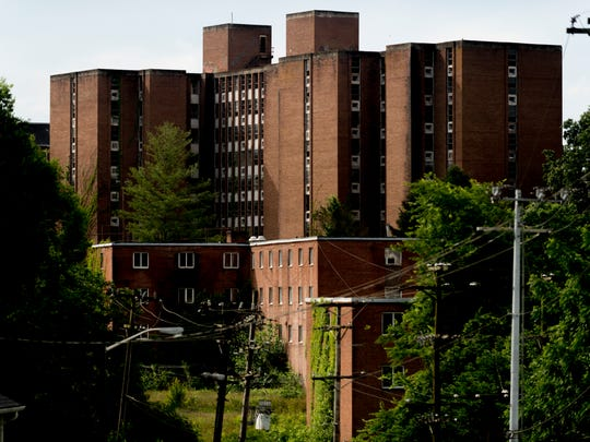The old Martin Luther King Towers are seen falling into disrepair on the Knoxville College campus.