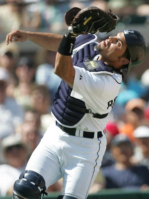 Tigers catcher Ivan Rodriguez catches a foul ball in a spring training game against the Cincinnati Reds at Joker Marchant Stadium in Lakeland, Fla., on March 2, 2006.