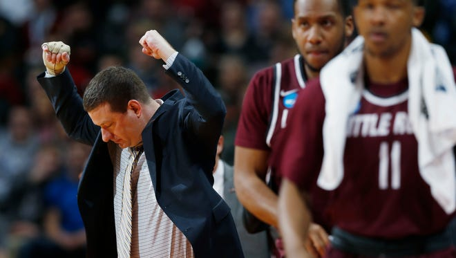 Former Arkansas Little Rock basketball coach Chris Beard reacts after his team draws a foul against Iowa State during the first half of a second-round men's college basketball game March 19, 2016, in the NCAA Tournament in Denver. Beard was hired Monday as UNLV's coach.