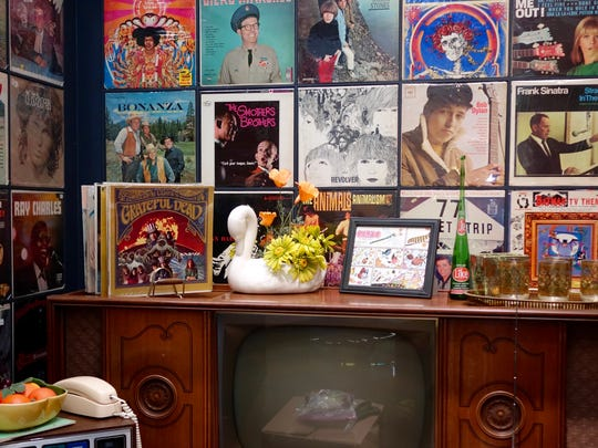 Record albums and a television set from the 1960's