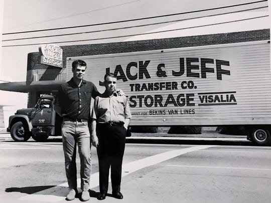 Jeff Black left stood next to his father Tom Black in front of a Jack and Jeff Transfer Co. truck.