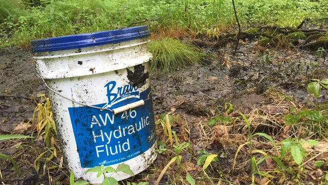 A container abandoned in an undeveloped lot near a stream off Lake Shore Road in Putnam Valley.