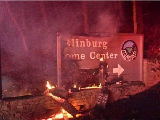 The Gatlinburg welcome center sign is partially destroyed
