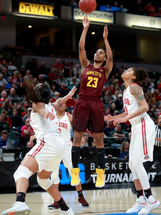 Minnesota guard Kenisha Bell (23) shoots over Ohio State guard Jensen Caretti, right, and Ohio State forward Stephanie Mavunga, left, during the first half of an NCAA college basketball game in semifinals of the Big 10 conference tournament, Saturday, March 3, 2018, in Indianapolis. (AP Photo/R Brent Smith)