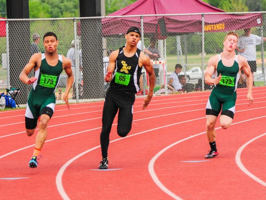 Tavian Dorsey of Delone Catholic, center, competes in the 200 at Saturday's District 3 Class AA track and field championships at Shippensburg University.
