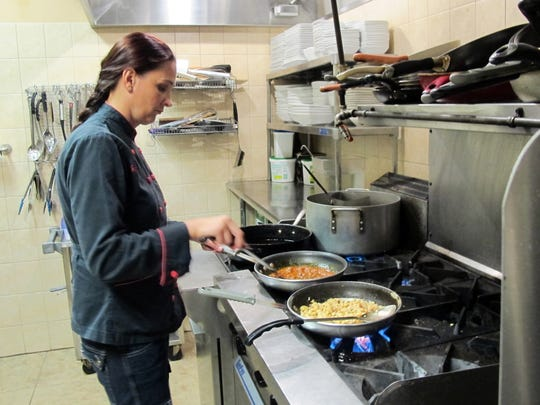 Chef Daniela Craciun prepares traditional Hungarian, Romanian and northern Italian cuisine in the kitchen at her Daniela's Restaurant in North Naples.
