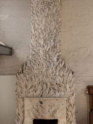 Robert Winthrop Chanler started designing Gertrude Vanderbilt Whitney's Greenwich Village studio in 1918. Pictured is the flame motif fireplace, which was originally painted in mostly bright red and gold.