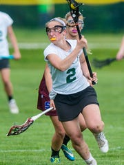 Rice Memorial's Lisa McNamara, seen in this file action photo, scored eight goals and had two assists in the Green Knights' win on Friday.