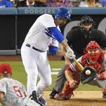 Jul 9, 2015; Los Angeles, CA, USA; Los Angeles Dodgers right fielder Andre Ethier (16) slips safe into home on an RBI double by Los Angeles Dodgers right fielder Yasiel Puig (66) (not pictured) against the Philadelphia Phillies in the fourth inning at Dodger Stadium. Mandatory Credit: Richard Mackson-USA TODAY Sports