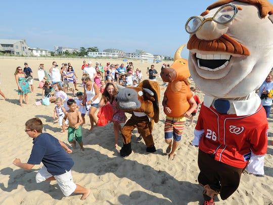 Kids enjoy fun with the Bull on the beach.