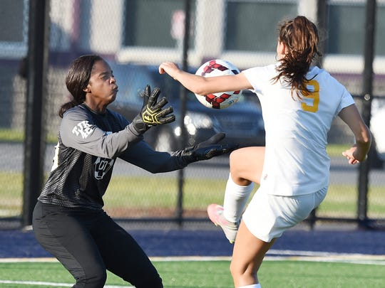 IR's Goalie Fabrea McCray blocks a shot by CR's #9 Jessie Prillaman as Indian River HS (green) and Caesar Rodney HS (white) played in the Henlopen Conference Girls Soccer Championship held at the Sussex Academy near Georgetown on Thursday May 18th. Chuck Snyder Photo