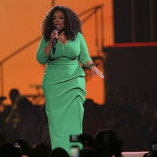 Oprah Winfrey takes the stage at The Palace of Auburn Hills in Auburn Hills on Friday September 12, 2014 during the 'Oprah's The Life You Want Weekend' tour.