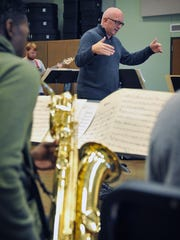 Dr. Matthew Luttrell conducts during a Midwestern State