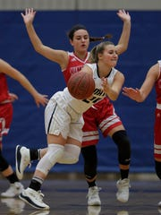 Kimberly High School's Lauren Smith, in back, defends against Appleton North High School's Sydney Levy during their girls basketball game Friday, December 1, 2017, in Appleton, Wis. Dan Powers/USA TODAY NETWORK-Wisconsin