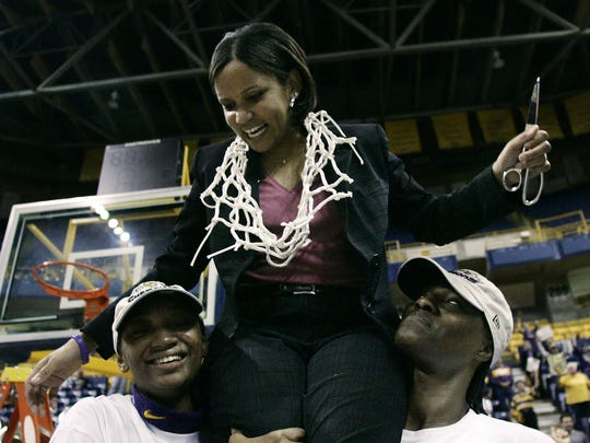 FILE – LSU coach Pokey Chatman is carried by Crystal