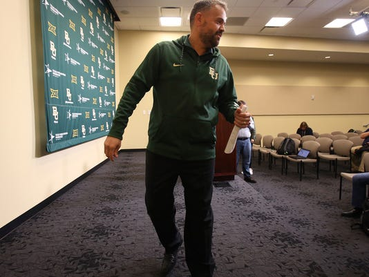 Baylor head football coach Matt Rhule exits the room after taking questions from the media Thursday, March 16, 2017 in Waco, Texas as discuss this upcoming season. ( Jerry Larson /Waco Tribune-Herald via AP)