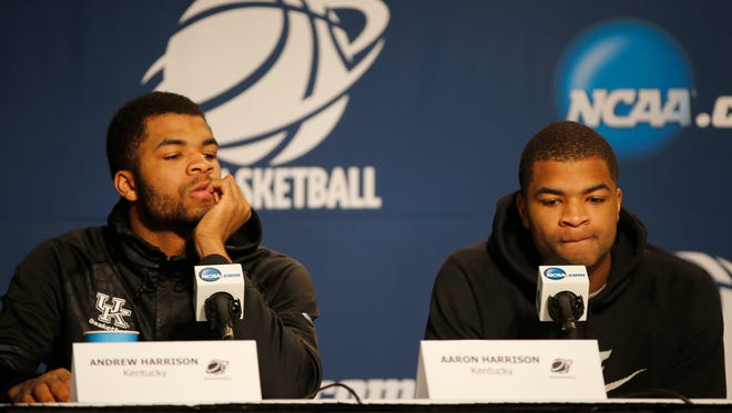 Kentucky Wildcats guards Andrew, left, and Aaron Harrison answer questions during a press conference March 27.