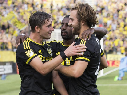 Jul 19, 2015; Columbus, OH, USA; Columbus Crew SC midfielder Ethan Finlay (13) celebrates with midfielder Mohammed Saeid (8) and defender Chad Barson (21) after scoring a goal against the Chicago Fire at MAPFRE Stadium. Columbus won 3-1. Mandatory Credit: Greg Bartram-USA TODAY Sports