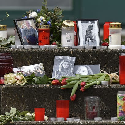 Pictures, flowers and candles are set on the steps