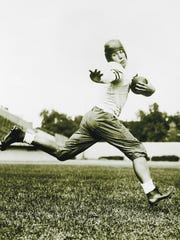 University of Chicago halfback Jay Berwanger is shown in 1934 in the action pose that served as the model for the Heisman Trophy. Berwanger was the first winner of college football's Downtown Athletic Club Award, renamed the Heisman Trophy, on Dec. 9, 1935.