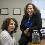 Tanya LaPrad, left, with her financial counselor Bettina Bartolo at Green Path Debt Solutions in Monroe, Mich.
