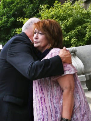 Elaine Sgorcea, mother of Richmond Hill victim John Dion Longworth, is hugged by Marion County Prosecutor Terry Curry outside the St. Joseph County Courthouse after the jury found Mark Leonard guilty of all 53 charges Tuesday, July 14, 2015.
