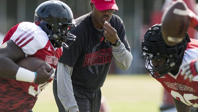 UL co-defensive coordinator Charlie Harbison supervises a defensive drill Tuesday at practice.
