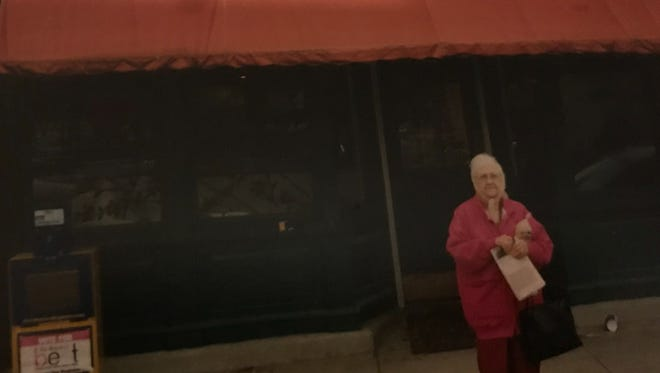After Rita Schiller's dad died, she and her sister would take their mother, Betty Meyer, on trips. Here is Betty standing outside of a bakery they stopped at in small town in Iowa.