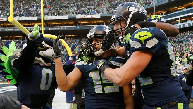 Seahawks WR Jermaine Kearse is mobbed after his game-winning TD.
