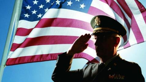Photo, silhouette of senior military chaplain saluting the American flag, Color, High res