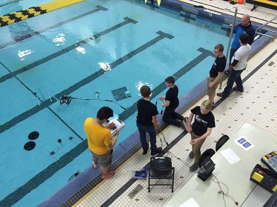 Oostburg Middle School's ROV team demonstrates its underwater ROV.