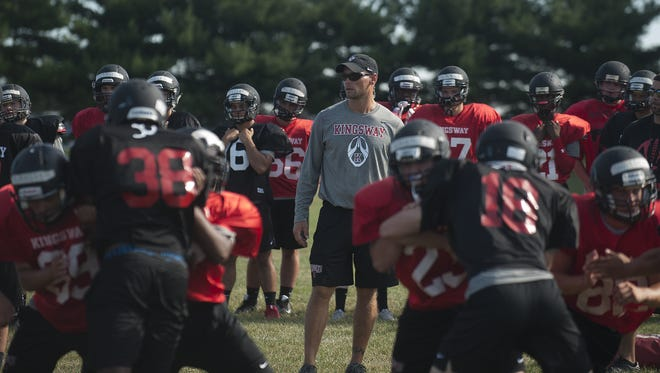 Kingsway coach Mark Hendricks (center) guided his team to a winning season and a sectional final appearance last fall.