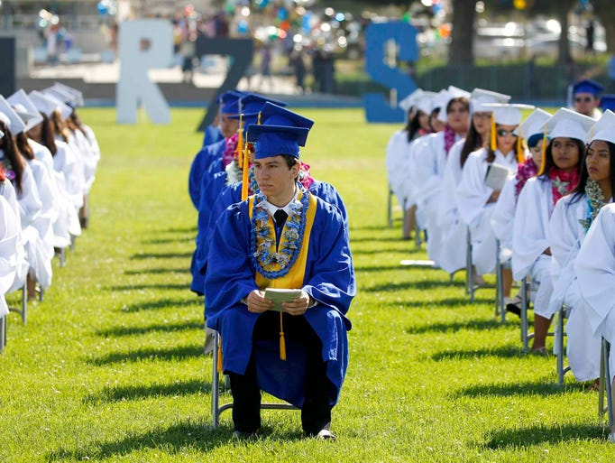 Graduates take their seats during the King City High