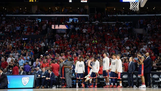 Mar 28, 2015; Los Angeles, CA, USA; Arizona Wildcats bench reacts during the 85-78 loss against Wisconsin Badgers during the second half in the finals of the west regional of the 2015 NCAA Tournament at Staples Center.