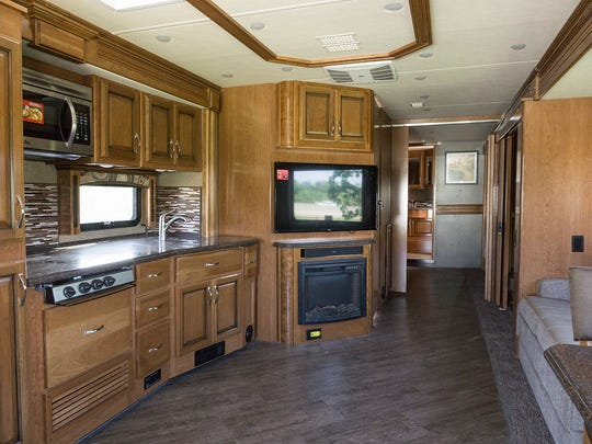 A bus-sized RV takes on large interior proportions when the bump-outs are extended. This model is built by Pace Arrow.