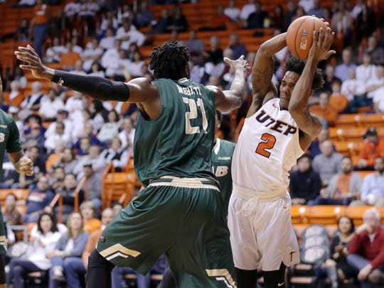 UTEP guard Omega Harris tries to avoid UAB's Tosin