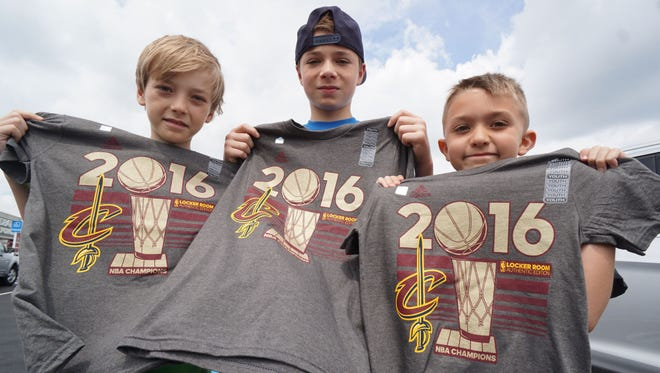 Wyatt Pry, 10, Leif Pry, 14, Bronson Pry, 8, all huge Cavaliers fans, show of their locker room edition t-shirts they purchased Monday morning at Dick's Sporting Goods.