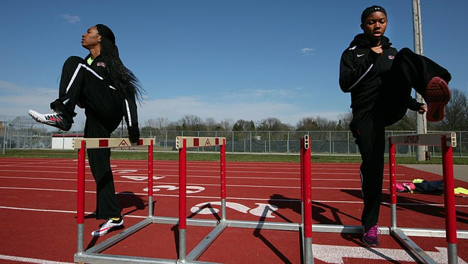 """Oak Park's Brianna Holloway, left, and Anna Jefferson warm up before a meet Wednesday. """"When we say we're from Oak Park, teams in the state don't like us,"""" said Jefferson."""