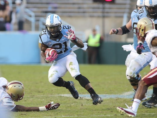 FILE - In this Oct. 26, 2013 file photo, North Carolina's Romar Morris (21) carries the ball in the second half against Boston College in an NCAA college football game in Chapel Hill, N.C. (AP Photo/Nell Redmond, File)
